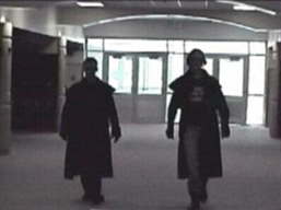 Eric Harris and Dylan Klebold in the halls of Columbine High School in the video Hitmen for Hire